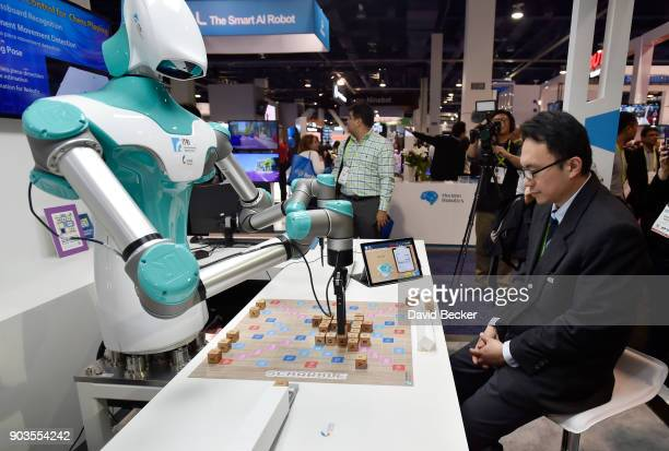 An intelligent vision robot plays Scrabble at the Industrial Technology Research Institute booth during CES 2018 at the Las Vegas Convention Center...