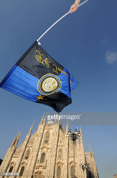 An Inter Milan supporter waves the team's flag over Piazza Duomo in Milan during the UEFA Champions league final football match Bayern Munich versus...