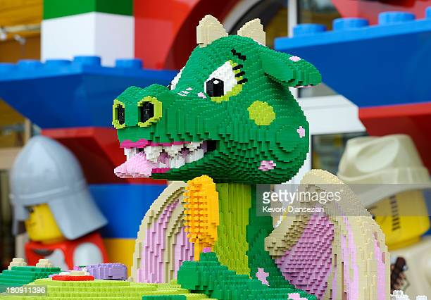 An interactive girl dragon named Bubbles takes a bath on the patio as she playfully sprays water and speaks to young guests of North America's first...