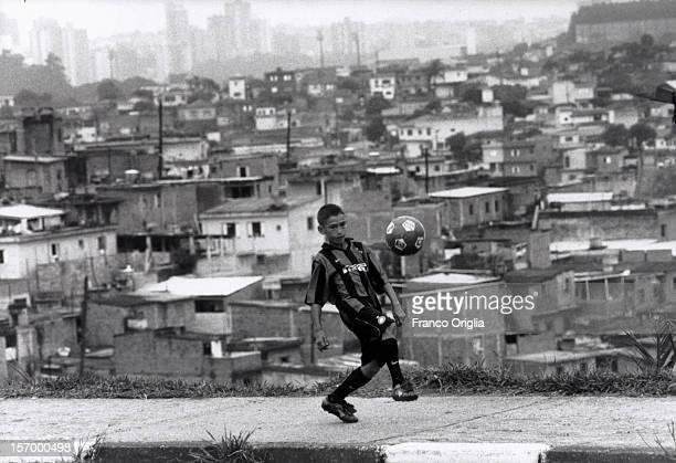 An InterCampus boy involved in the Intercampus project controls the ball at the Santo Andre favelas on December 13 1997 in Sao Paulo Brazil Since...