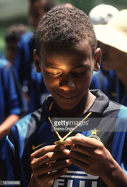 An InterCampus boy involved in the Intercampus project looks his medal on December 16 1997 in Recife Brazil Since 1997 Inter Campus has implemented a...