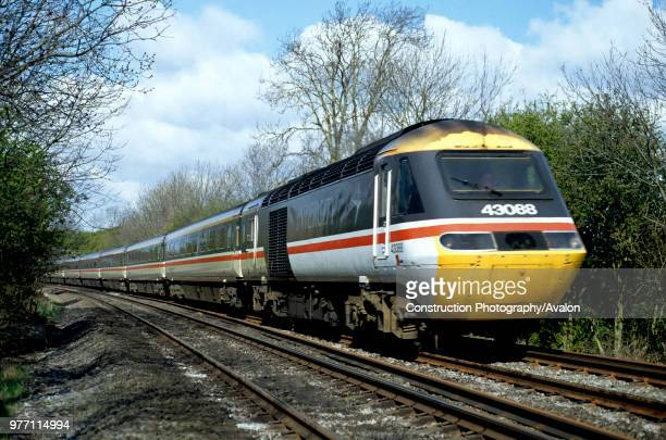 An InterCity High Speed Train in British Rail colours curves away from Newton Harcourt on a glorious spring morning, United Kingdom.