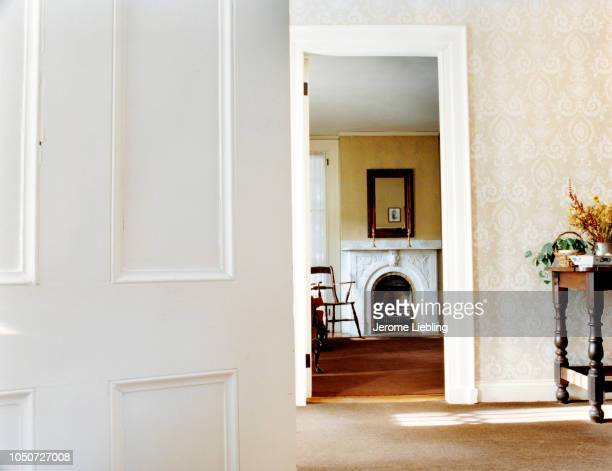 An interior view into the front parlor with a fireplace mantel of the Emily Dickinson Homestead Amherst Massachusetts 1993 The view looks in from the...