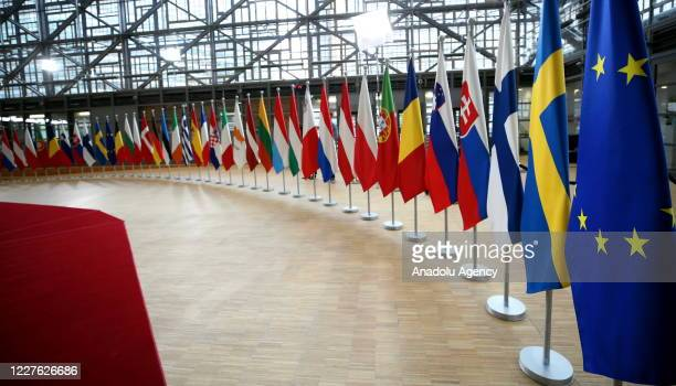 An interior view of a hall of the European Council building with EU member flags ahead of a meeting to discuss Commission proposal in response to...