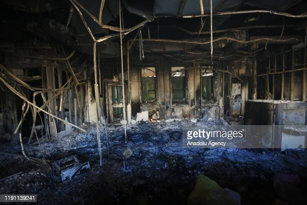 An interior view of damaged room is seen as crowd leave the site after Iranianbacked Hashd alShaabi group urges its members to withdraw from around...