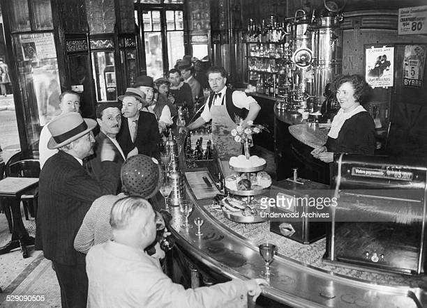 An interior view of patrons at the bar in the Cafe Gourand in the Montmartre district Paris France 1935