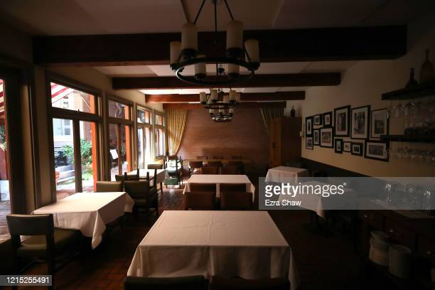An interior view of the empty dining room at Sociale on March 27 2020 in San Francisco California Sociale is working with a reduced staff and are...