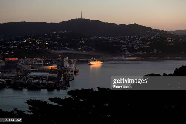 An Interislander ferry operated by Kiwirail Ltd center sails across the Cook Strait at dawn in Wellington New Zealand on Wednesday July 18 2018 New...