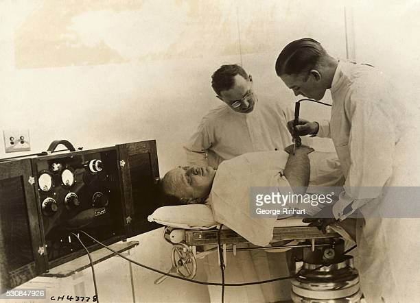 An intern in the Alexian Brothers Hospital Chicago using the radio knife just invented by Louis Schmidt MD The 'knife' is one terminal of a low power...