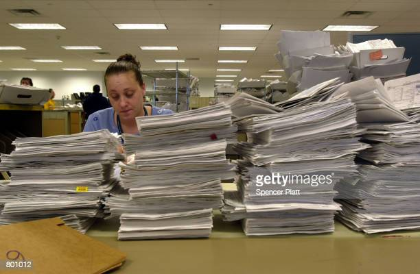 An Internal Revenue Service employee processes tax returns in the mail room April 12 2001 at the IRS East Coast headquarters in Brookhaven New York...