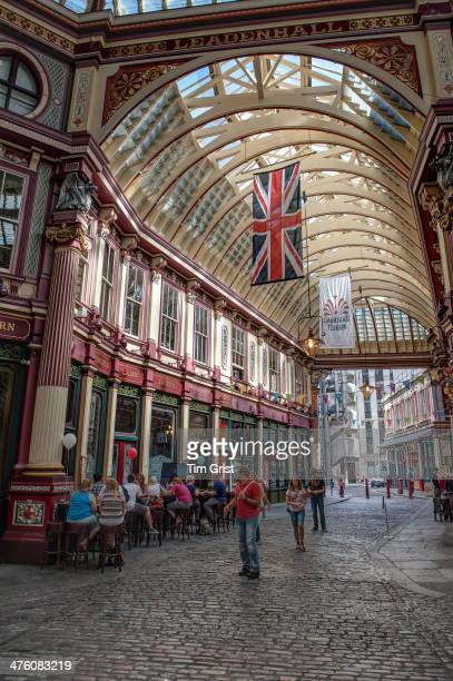 CONTENT] An internal view of Leadenhall Market with visitors walking along the cobbled street