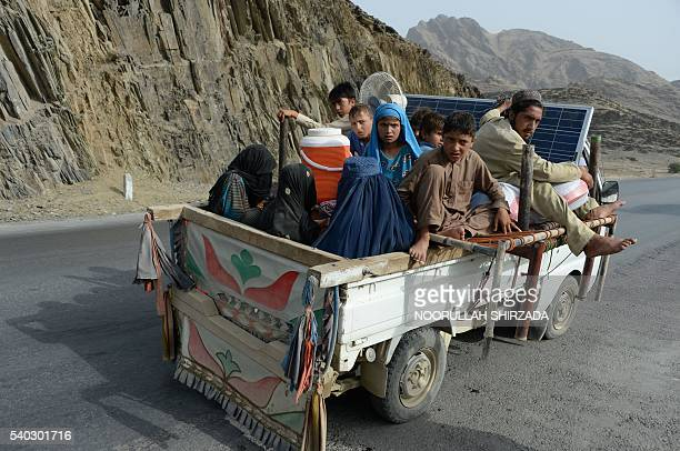TOPSHOT An internally displaced Afghan family flees their home following clashes with Pakistani forces on the border between Afghanistan and Pakistan...