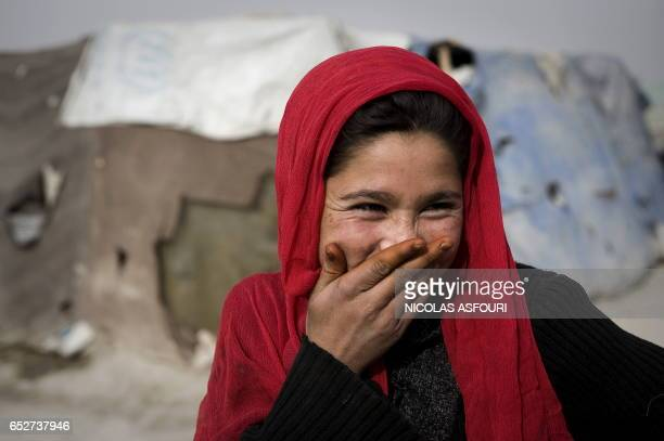 An internally displaced Afghan laughs in a camp in Kabul on November 4 2009 Former presidential challenger Abdullah Abdullah said Hamid Karzai's...