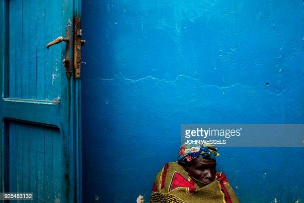 TOPSHOT An Internally Displaced Congolese woman sits on the ground out side a camp for the Internally displaced on February 27 2018 in Bunia...