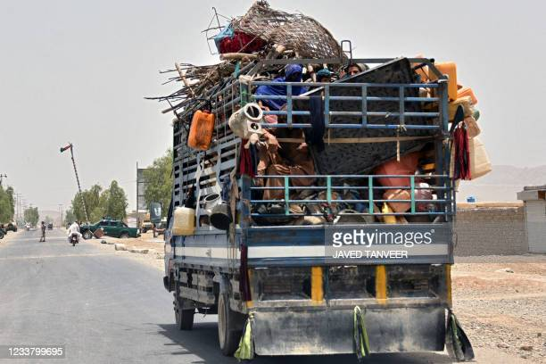 An internally displaced family flees towards the city in Panjwai district of Kandahar province on July 4 after the Taliban captured a key district in...