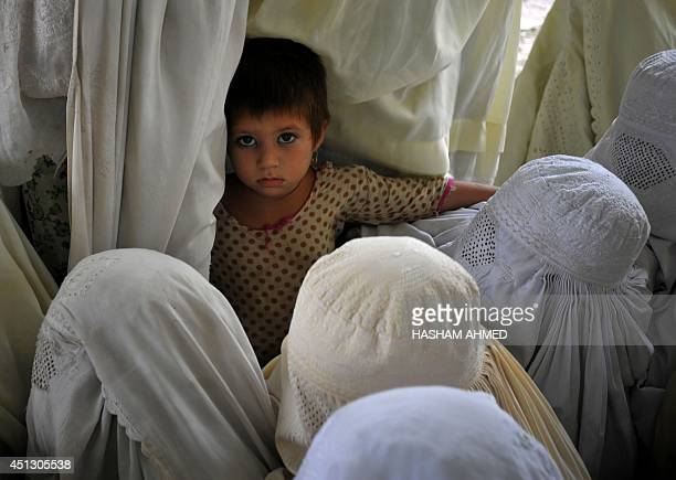An internally displaced Pakistani child stands among civilians fleeing a military operation against Taliban militants in the North Waziristan tribal...