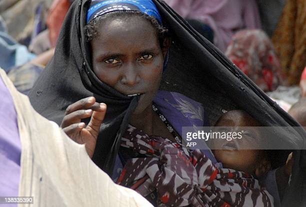 An internally displaced Somali mother stands with her child at an IDP camp in Mogadishu July 22 2011 waiting for humanitarian assistance Somalia's Al...