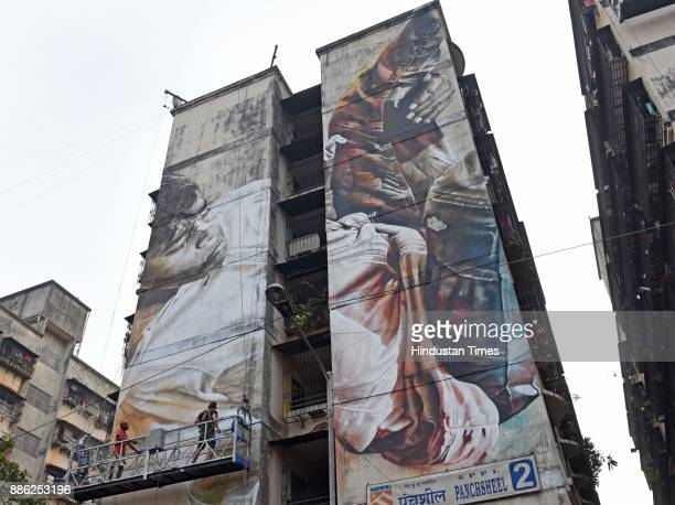 An international artists paint the wall of building at Dharavi Mahim on December 3 2017 in Mumbai India