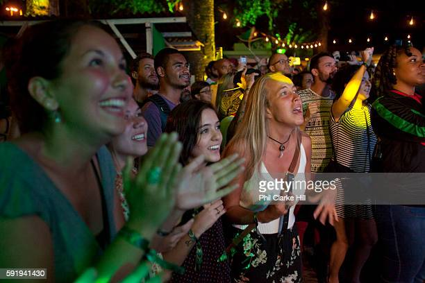 An International Brazilian and Jamaican crowd in Jamaica House celebrate Usain's Bolt's 200m Olympic victory Rio 2016 Gavea Jockey Club Rio de Janeiro