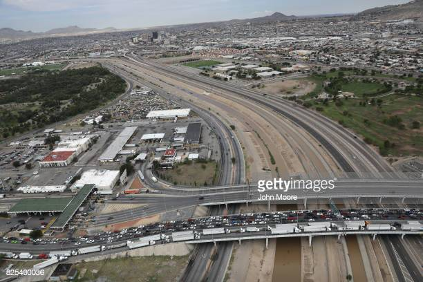 An international bridge crosses the Rio Grande which forms the USMexico border as seen from a US Customs and Border Protection helicopter on August 1...