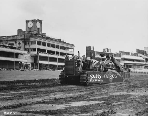 An International Harvester Crawler T series Tractor at work during the reconstruction at Ascot Racecourse as the old Grand Tier and Alexandra Stands...