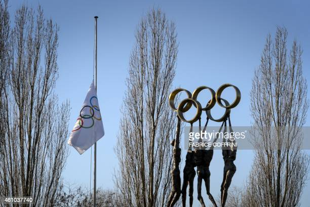An International Olympic Committee flag flies at half-mast at IOC headquarters on January 5, 2015 in Lausanne. The IOC announced on January 4 that...