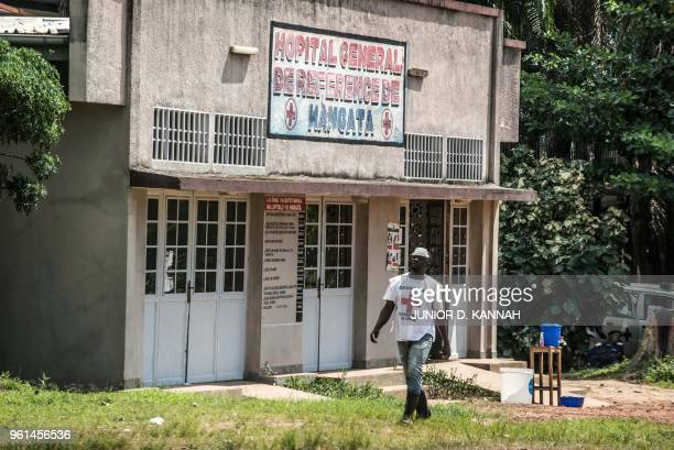 TOPSHOT An International Red Cross Committee staff member walks in front of a quarantine zone at the hospital of Wangata in Mbandaka on May 22 in the...