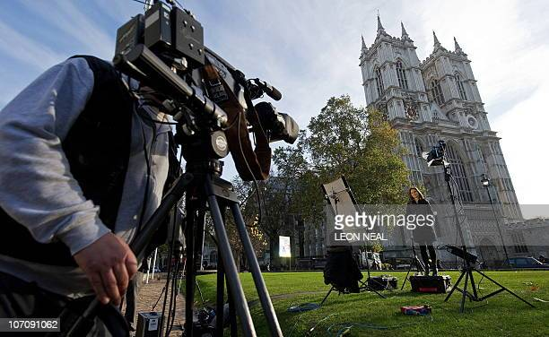 An International television journalist prepares to report from opposite Britain's Westminster Abbey in central London on November 19 2010 A leading...