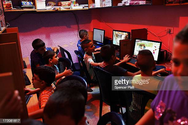 An internet cafe is utilized by young Lebanese and Syrian children in a poor neighborhood with a high concentration of Syrian refugees on July 01...