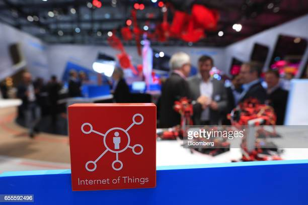 An 'Internet of Things' logo sits on display in the edge analytics pavilion at the CeBIT 2017 tech fair in Hannover Germany on Monday March 20 2017...