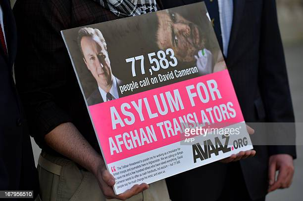 An interpreter named only as Mohammed holds a petition signed by over 70000 people calling for assylum for Aghan interpreters who served the British...