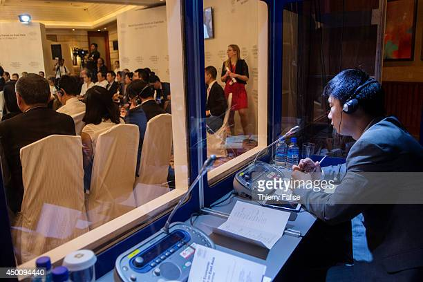 An interpreter works during a participants session at the World Economic Forum on East Asia held in Manila on May 2123