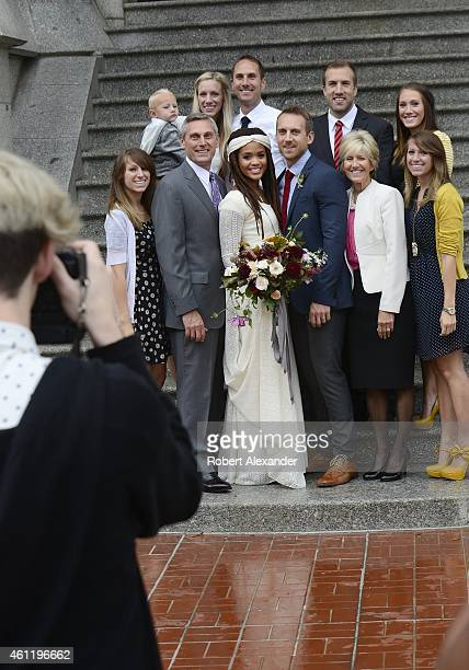 An interracial couple pose for a photograph with members of their wedding party after their wedding ceremony in the Salt Lake Mormon Temple in Salt...