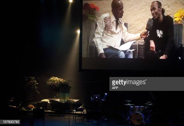 An interview of Bobby Farrell is projected on a giant screen during his funeral ceremony on January 8 2011 at the Stadsschouwburg theatre in...