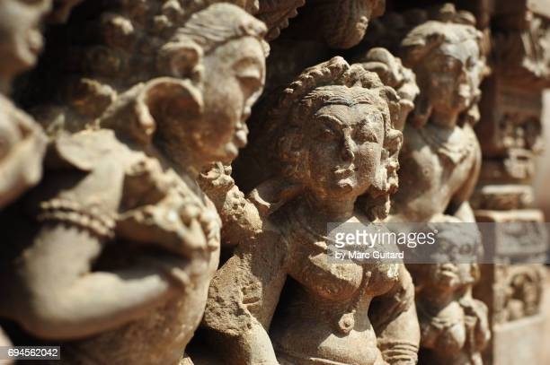 an intricate sculpture depicting hindi deities at the harshat mata temple in the village of abhaneri, rajasthan, india - abhaneri stock photos and pictures