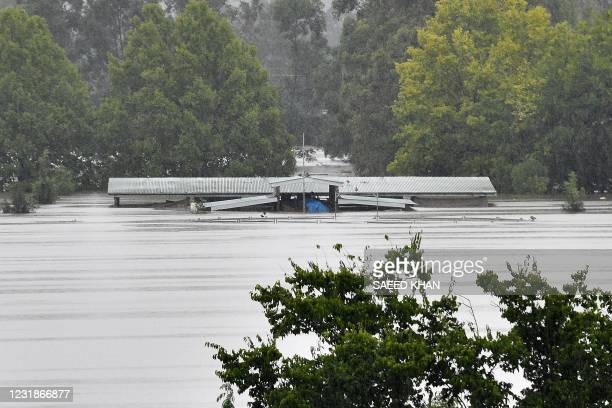 An inundated barn is seen in the floodwaters in the residential area of Richmond suburb on March 22 as Sydney braced for its worst flooding in...
