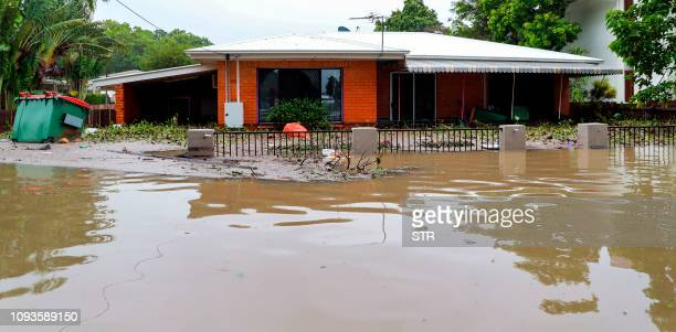 An inundated house is seen in Townsville's floodwaters on February 4 as the recent downpour in Australia's tropical north has seen some areas get a...