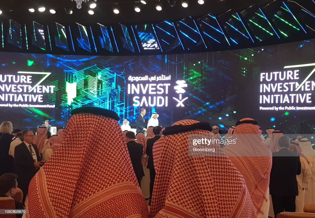 An 'Invest Saudi' advertisement sits on the stage backdrop