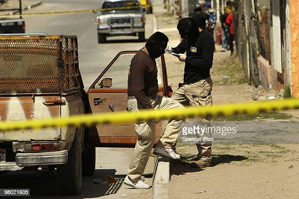 An investigative team analyzes the scene of the murder of two women aged 17 and 21 March 24, 2010 in Juarez, Mexico. Secretary of State Hillary...