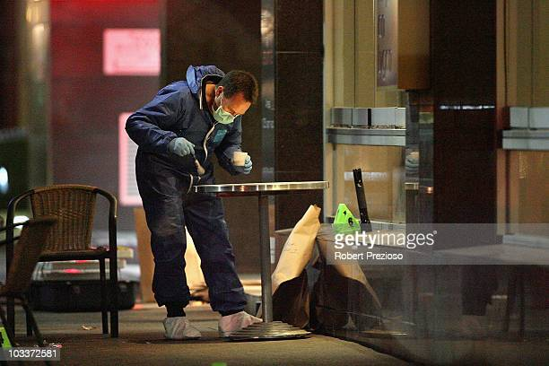 An Investigator asses the crime scene where two men were shot dead on Lygon Street in the CBD on August 13 2010 in Melbourne Australia The two men...