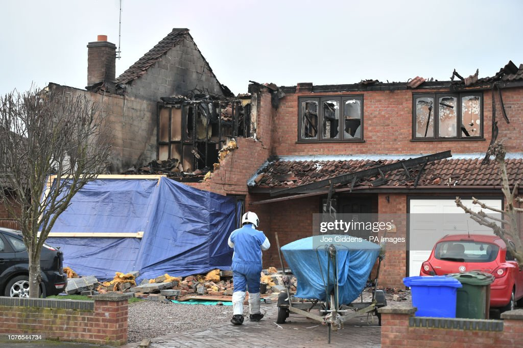 Police launch murder inquiry after three die in house fire : News Photo
