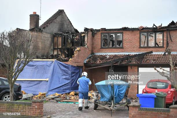 An investigator at the scene after a house fire in Peartree Road Kirton near Boston in Lincolnshire where police have launched a domesticrelated...