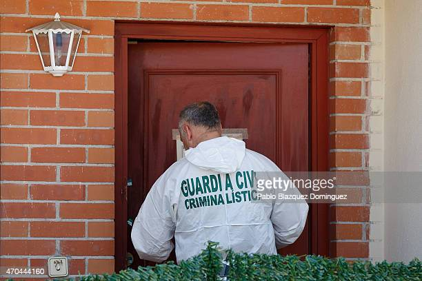 An investigator enters a house while other Guardia Civil members search in the presence of a suspect arrested in connection to the disappearance of...