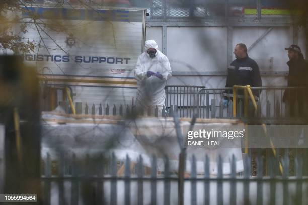An investigator in a forensics suit works at the helicopter crash site outside Leicester City Football Club's King Power Stadium in Leicester eastern...