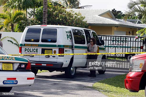 An investigator loads material into a police vehicle in front of the home where an intruder shot Washington Redskins football player Sean Taylor in...