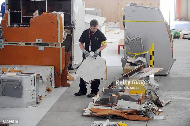 An investigator of the BEA inspects debris from the midAtlantic crash of Air France flight 447 on July 24 2009 at the CEAT aeronautical laboratory in...