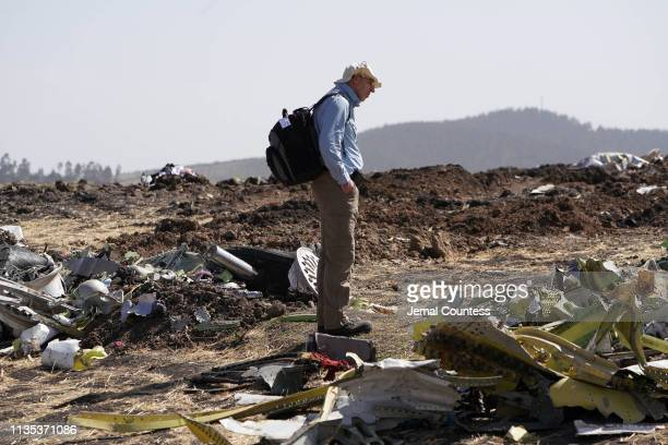An investigator with the US National Transportation and Safety Board looks over debris at the crash site of Ethiopian Airlines Flight ET 302 on March...