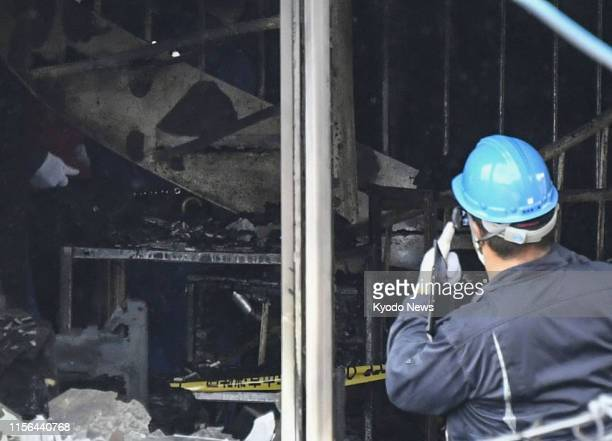 An investigator works in Kyoto on July 19 at the threestory studio of Kyoto Animation Co that was set on fire by a man the previous day leaving more...