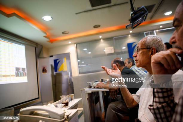 An investor gestures as he watches trading screens at the Al Hekma Financial Services office at the Housing Bank Complex in Amman Jordan on Thursday...