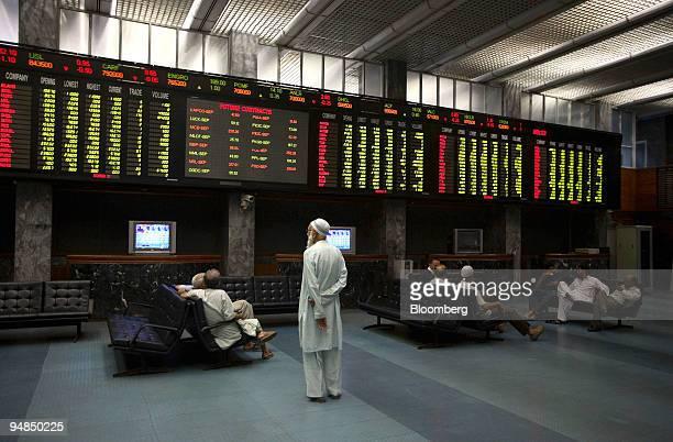 An investor monitors the index at Karachi Stock Exchange in Karachi Pakistan on Monday Sept 8 2008 Pakistan's Asif Ali Zardari is set to take over as...